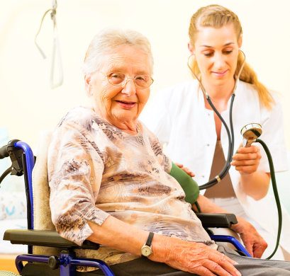 senior woman smiling and a doctor checking her health condition