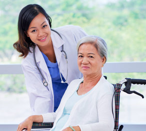 senior woman sitting on a wheelchair and a doctor