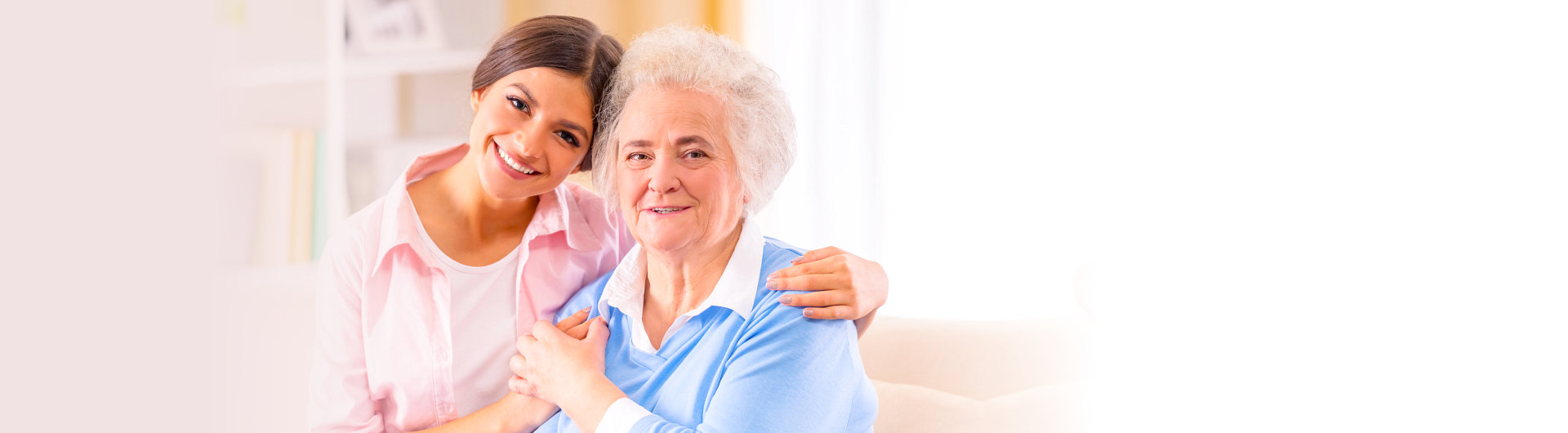 elderly woman and young woman smiling